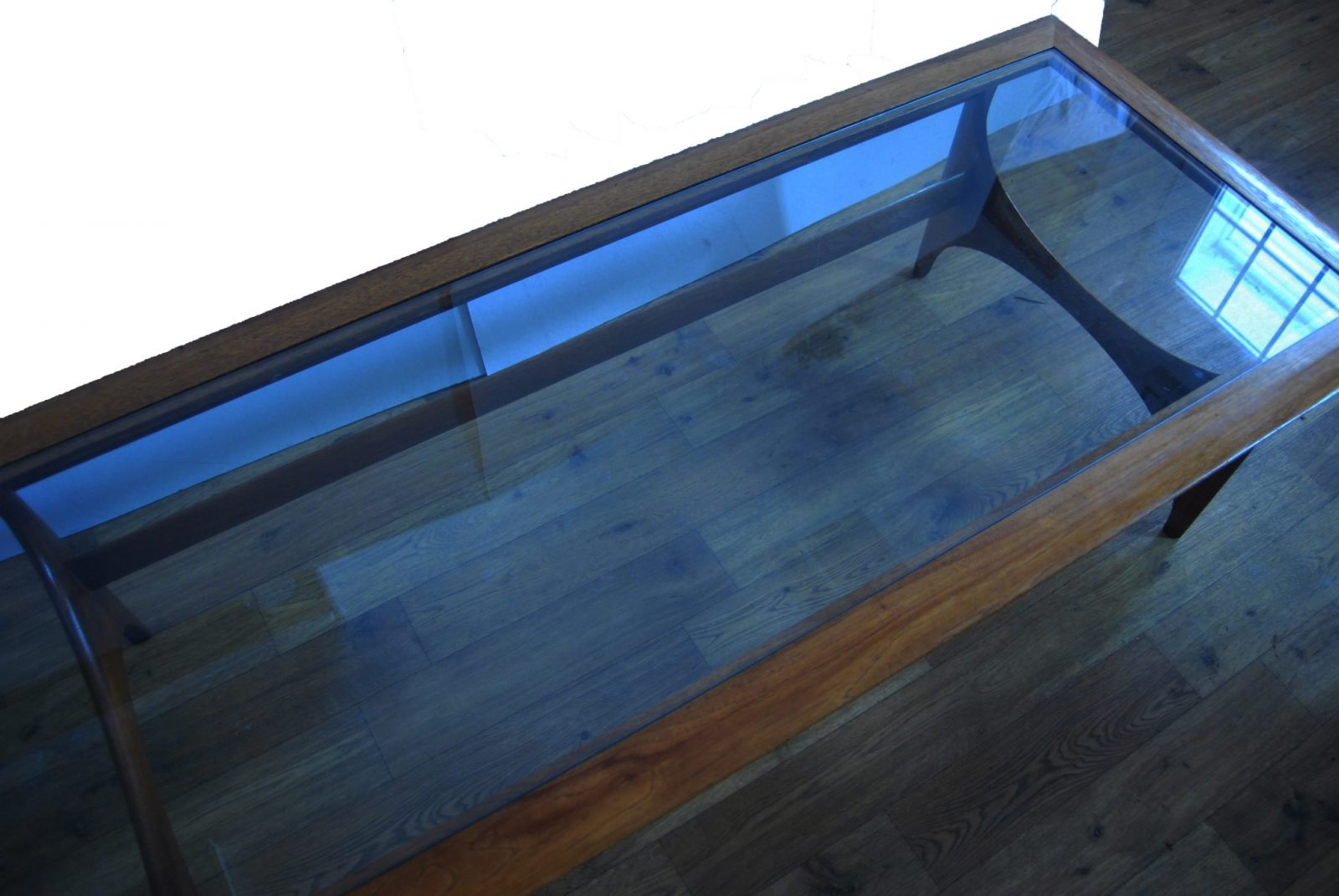 Sculptured walnut cocktail table with glass top