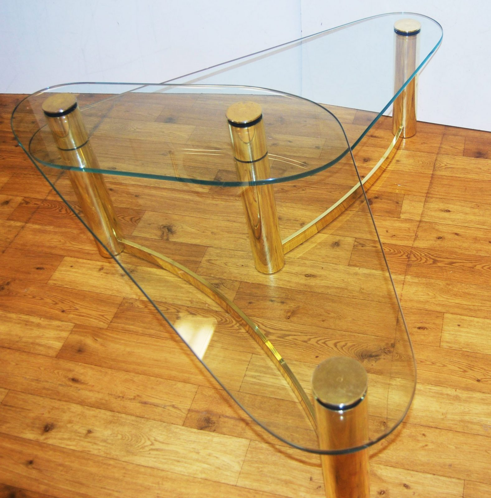 1970s tubular brass and glass asymmetrical two tier coffee table